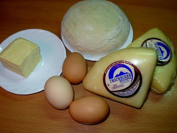 طريقة عمل فطائر القارب الشهية بالبيض والجبن صور